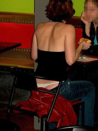 Low-rise pants - Woman in 2001 wearing low-rise jeans exposing her thong, an early 2000s fashion trend referred to as a whale tail