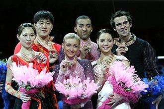 2008 World Figure Skating Championships - The pairs' podium. From left: Zhang Dan / Zhang Hao (2nd), Aliona Savchenko / Robin Szolkowy (1st), Jessica Dubé / Bryce Davison (3rd).