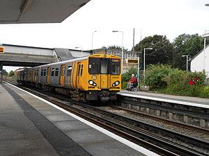 Meols railway station - Image: 508122 arrives at Meols