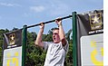 A Boy Scout performs a pull-up at an Army recruiting station during the National Scout Jamboree in Mt. Hope, W.Va., July 17, 2013 130717-A-QD273-139.jpg