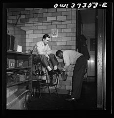 A Greyhound driver getting his shoes shined by a porter 8d32955v.jpg