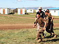 A Mongolian service member runs through a pepper spray qualification course during Non-Lethal Weapons Executive Seminar (NOLES) 13 at Five Hills Training Area, Mongolia, Aug. 21, 2013 130821-M-DR618-105.jpg