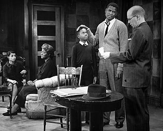Ruby Dee - Photo of a scene from the play A Raisin in the Sun. From left: Dee, (Ruth Younger); Claudia McNeil, (Lena Younger); Glynn Turman, (Travis Younger); Sidney Poitier, (Walter Younger) and John Fiedler, (Karl Lindner).