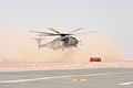 A U.S. Navy MH-53E Sea Dragon helicopter assigned to Helicopter Mine Countermeasures Squadron (HM) 15 prepares to land during practice drills for moving a generator in Kuwait April 11, 2009 090411-N-QT558-013.jpg