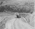 A carrier truck driving on a gravel road (AM 88065-1).jpg