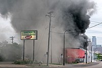 A fire burns at maX it PAWN in Minneapolis, Minnesota on Friday morning. (49948399113)