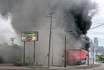 A fire burns at maX it PAWN in Minneapolis, Minnesota on May 29