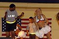 "A soldier is shown dancing ""The Electric Slide"" with a member of the National Football League's Denver Broncos Cheerleaders at the Kandahar Air Field in Afghanistan on July 3, 2005 050703-A-FG235-022.jpg"