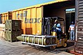 A workman uses a forklift to move a pallet of Mark 84 2,000-lb. bombs.jpg
