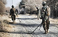 Afghan National Army Soldiers Search Roadway for IEDs MOD 45152178.jpg