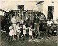 African-American children line up outside of Albemarle Region bookmobile.jpg