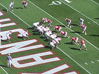 American football players line up in a goal line formation.