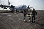 An Armed Forces of the Philippines service member, right, and his family visit a U.S. Marine Corps KC-130J Hercules aircraft on display at Clark Airfield, Pampanga province, Philippines, Oct. 6, 2013, during 131006-M-GX379-264.jpg