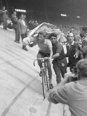 1957 Tour de France - General classification winner Jacques Anquetil taking his victory lap at the end of the Tour in the Parc des Princes in Paris