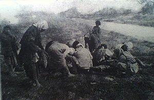 Deir ez-Zor Camps - Armenian refugees collected near the body of a dead horse at Deir ez-Zor