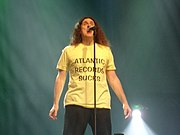 """Weird Al wearing his """"Atlantic Records Sucks"""" shirt during a performance of """"You're Pitiful"""", on August 8, 2007, at the Ohio State Fair."""