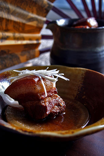 Dongpo pork is a Hangzhou dish[5] which is made by pan-frying and then red cooking pork belly.