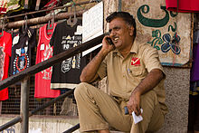 Bangalore blue collar guy on cellphone November 2011 -34.jpg