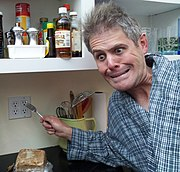 Bart pretends to put a fork into an electric socket.jpg