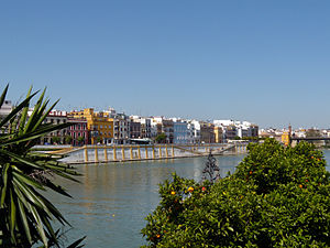 Districts and neighbourhoods of Seville - Betis Street (Triana) and Guadalquivir River