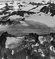 Blockade Glacier, feeder of valley glacier with firn line, and hanging glaciers on the surrounding mountainsides, August 23, 1960 (GLACIERS 6415).jpg