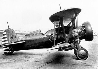 1st Operations Group - 27th PS Boeing P-12E at Selfridge Field. The fuselage is olive drab, the wings yellow, and the cowl ring red.
