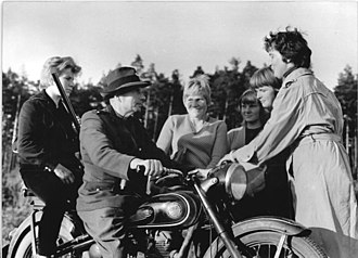 Stakhanovite movement - After Stalin's death in 1953 the USSR and the countries of the socialist camp continued to encourage workers to exceed production targets and to publicise those who did so. In September 1959 near Neustrelitz, East Germany, a forester on his AWO 425T motorcycle congratulates a team of women who achieved 184% of work target by planting 25,000 saplings in the time that they were set a quota of 16,000.