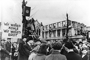 Cold War (1947–1953) - The hunger-winter of 1947, thousands protest in West Germany against the disastrous food situation (March 31, 1947). The sign says: We want coal, we want bread
