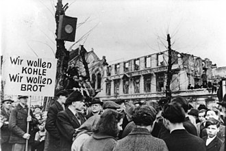 Marshall Plan - The hunger-winter of 1947, thousands protest in West Germany against the disastrous food situation (March 31, 1947). The sign says: We want coal, we want bread