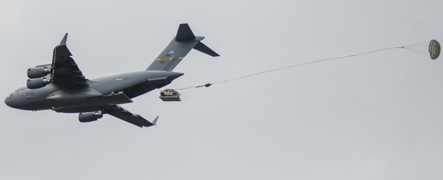 File:C-17 airdropping HUMV.png - Wikimedia Commons