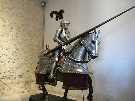 Mounted armoured knight. Armour and cavalry dominated the battlefield, until the invention of firearms. Caballero Armadura 4 Alcazar Segovia 2010.jpg