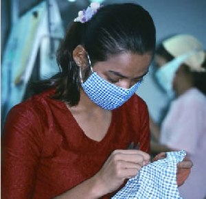 Economy of Cambodia - A garment factory worker in Cambodia undertaking health precautions