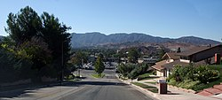 A neighborhood in the Sierra Pelona Mountains, in Canyon Country near the central Sand Canyon and Soledad Canyon Roads junction with the San Gabriel Mountains in the background.