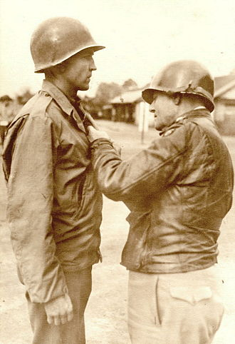 Lucian Truscott - Truscott pins the Bronze Star on Captain Richard Wolfer, France, 25 October 1944.