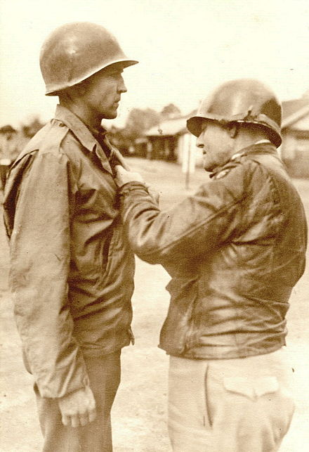 Truscott pins the Bronze Star on Captain Richard Wolfer, France, 25 October 1944. Capt. Richard Wolfer receiving Bronze Star from Gen. Truscott in France.jpg