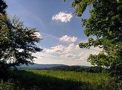 A view from Fairfield Township with Chestnut Ridge in the distance
