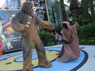 Star Wars Weekends - Chewbacca and a Jawa compete in the contest with Bee Gees'-styled disco moves during Star Wars Weekends.