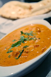 Chicken tikka masala British-Indian curry ( Invented by Indian chefs in Glasgow , UK)