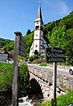 Church of Geschwend with a traditional stone archbridge and lots of walking signs - panoramio.jpg