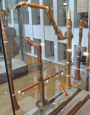 Basset horn - Museum of Musical Instruments, Berlin: 18th-century basset horns (with clarinets, a flute, and bassoons)