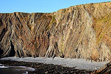 Coloured strata on the cliffs on Warren Beach - geograph.org.uk - 1518539.jpg