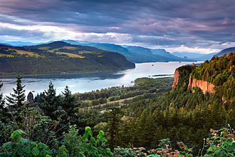 The Columbia Gorge marks where the Columbia River splits the Cascade Range between the states of Washington and Oregon. Columbia River Gorge (3).jpg