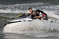 Couple of teenagers with scared female passenger on a jetski in Laos.jpg