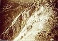Crew cutting rock on a steep slope of Tunnel Mountain to construct grade of the White Pass & Yukon Railway, Alaska, 1898 (MEED 226).jpg