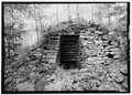 DETAIL OF WORK ARCH (OR POSSIBLY THE TUYERE ARCH) OF FURNACE LOOKING EAST - Shade Furnace, Reitz, Somerset County, PA HAER PA,56-ROCK.V,1-2.tif