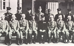 Tadashige Daigo - Vice Admiral Tadashige Daigo, seated in uniform, with members of his staff and kaiten pilots (with bandanas) of I-36