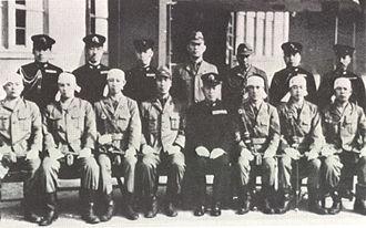 Tadashige Daigo - Vice Admiral Tadashige Daigo, seated in uniform, with members of his staff and kaiten pilots (with bandanas) of I-36
