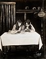 Daisy and Violet Hilton, conjoined twins, taking tea. Wellcome V0029582.jpg