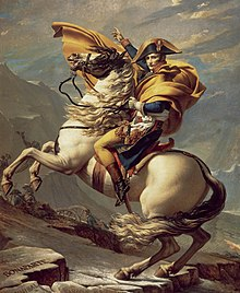 Napoleon on a rearing white horse pointing his men to continue their advance through a mountain pass.