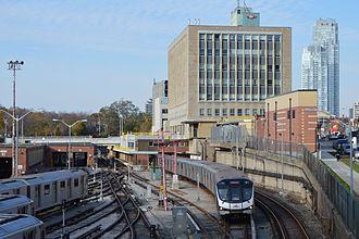 Davisville station - Looking north at Davisville Yard, Davisville subway station, McBrien Building and a Toronto Rocket train departing southbound